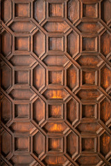 Pattern of carved on wood for decoration. Wooden texture with metalic decoration. Background. Copy space.
