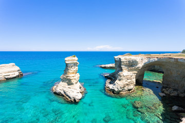 Sant Andrea, Apulia - Turquoise water at the rocky cliffs of Sant Andrea