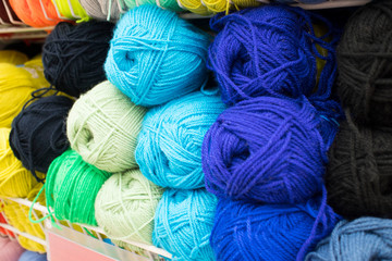 Coloured wool yarn into skeins and tangles. Bright yarn for knitting.
