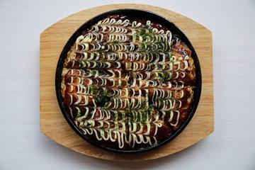 Japanese food okonomiyaki , Japanese pizza on wood plate