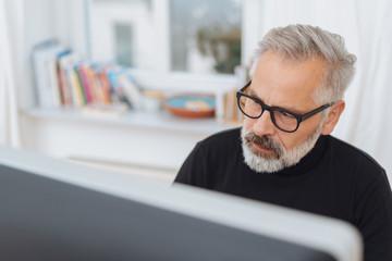 bearded businessman engrossed in his work