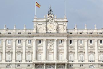 The neoclassical Royal Palace (Palacio Real) of Madrid entrance as seen from the Armory Square (Plaza de la Armeria), in a sunny summer day, Spain