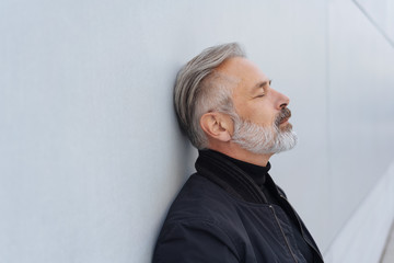 Middle-aged bearded man taking a moment to relax