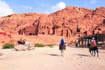 Tourists ride on donkeys in Petra, Jordan