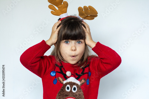 b9b7c7ab243cd Christmas sale. Beautiful surprised child in Santa Claus hat ...