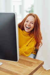Young woman laughing merrily