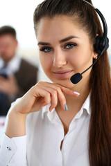 Beautiful brunette smiling call centre clerk at work