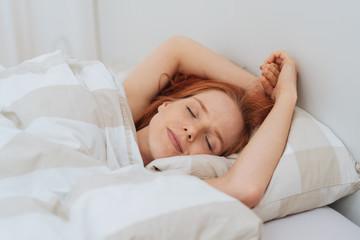 Attractive young woman enjoying a restful sleep