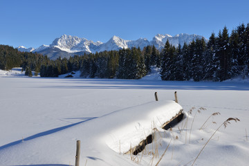 Germany, Werdenfelser Land, Kruen,  view to Karwendel mountains and frozen snow-covered Lake Geroldsee