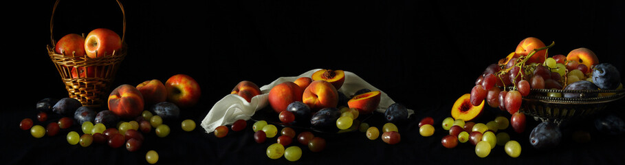 Large-format panorama-still life with fruit on a dark background