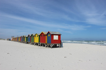 Colorful huts on Muizenberg Beach on warm summers day