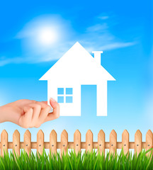 Creative Template Design for Real Estate. Hand holding a paper house. Vector illustration.