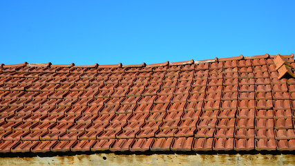 Roof with red tiles. Roof of Small country house.