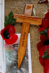 Poppies, pictures and a remembrance cross are seen at the Franco-British National Memorial in Thiepval