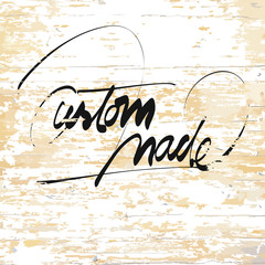 custom made lettering on wooden background
