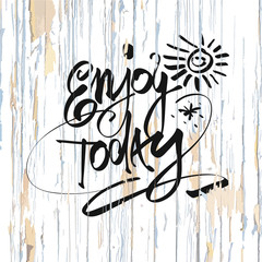 Enjoy today lettering on wooden background