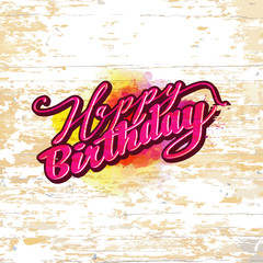 Happy birthday lettering on wooden background