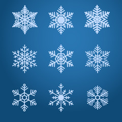Vector snowflakes icons set on dark blue background.
