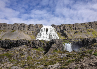Magnificent Dynjandi waterfall Jewel of the Westfjords of Iceland in sunny weather and blue sky