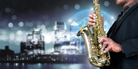 Close-up man playing on saxophone on background