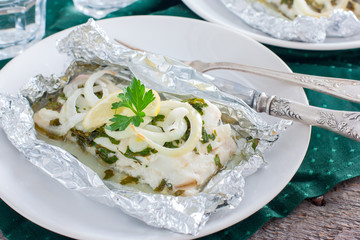 Cod baked in foil with parsley and onion, horizontal