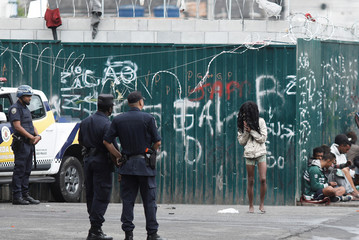 """Metropolitan Police monitor """"Cracolandia"""" (Crackland), an abandoned site that has become a drug haven for addicts, ahead of a visit of members of Inter-American Commission on Human Rights, at Luz neighborhood in Sao Paulo"""