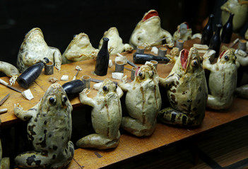 Frogs representing eating at an electorate diner are pictured at the Frog Museum in Estavayer-le-Lac