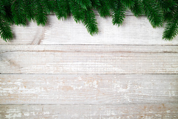 Christmas card. Christmas background with christmas fir tree on old wooden table. Winter holidays concept. Top view. Copy space