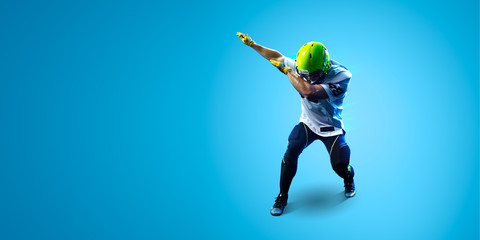 American football sportsman player on blue gradient background. Sport wallpaper or advertising