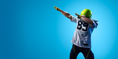 American football sportsman player on blue gradient background. Sport advertising