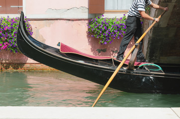 Venice canal, channel and gondolier