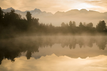 Reflections of Southern Alps at Lake Matheson on early morning, West Coast South Island, New Zealand natural landscape background