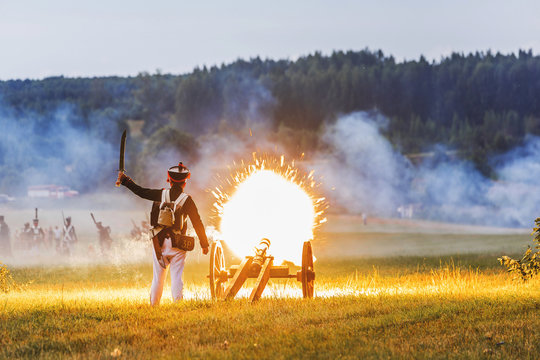 Gun Shot With Flame. Historical reconstruction of the war of 1812. The battle near Smolensk. Russia