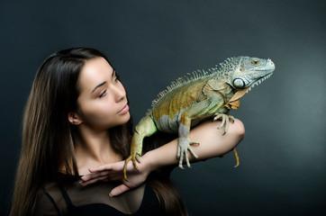 Beautiful sensual woman and dragon in the studio.