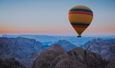 Hot air balloon over Mount Moses Sinai sunset