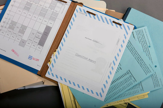 A stack of open file folders