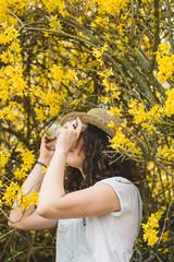 Woman taking shots in woods