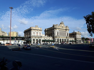 An amazing views of the pld station of Genoa in autumn with a great blue sky and some old parts of the city