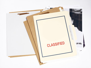 Several confidential file folders with pictures