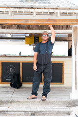 Fisherman Standing at Rental Shack