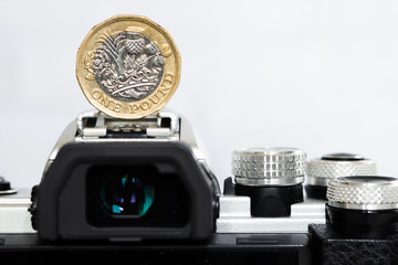 British Money, Pound coin on top of a Mirrorless DSLR Camera