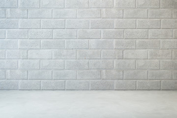 empty room with brick wall and concrete floor