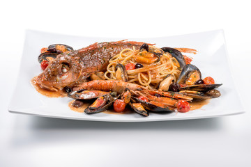 Plate of spaghetti with Tub gurnard prawn mussels olives and tomatoes