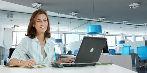 Woman working on modern office