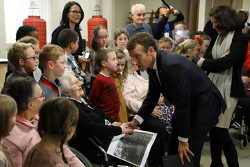 French President Emmanuel Macron meets people as he visits an EHPAD in Rozoy-sur-Serre