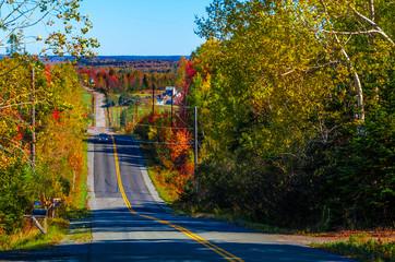 Country Road in Autumn - Noel Road, Nova Scotia, Canada - October 13, 2014.  A lone car travels a rural Nova Scotia road in autumn.