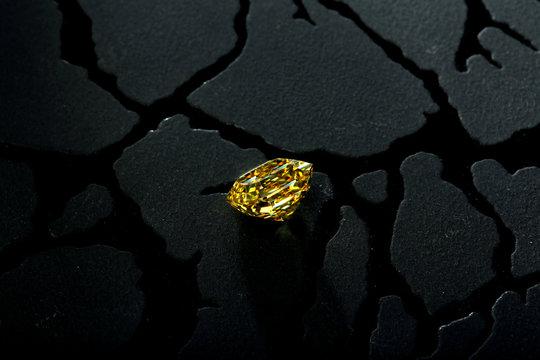Yellow Diamond on Black Stone Background