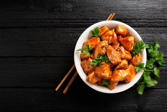 Spicy sweet and sour general tso chicken .