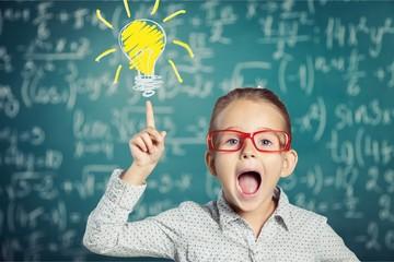 Little girl has and idea on chalkboard