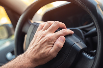 Nervous driver pushing car horn